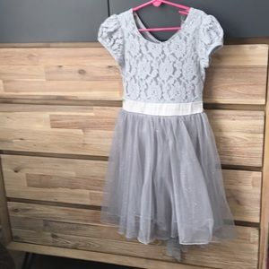 Formal short sleeve silver/gray party dress.